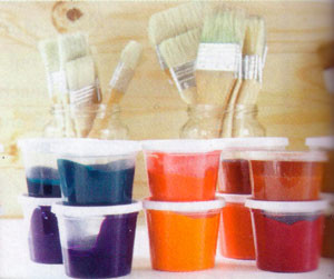 pots of pigments and brushes