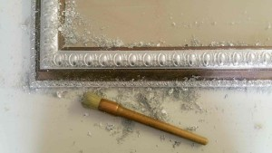 Silver leafing frame in the workroom
